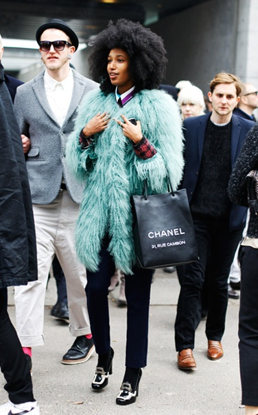 Half-French, half-Senegalese model Julia Sarr-Jamois was spotted on the streets of Milan in January this year sporting a Philosophy di Alberta Ferretti coat, Christopher Kane trousers, Prada jumper, Alberta Ferretti shirt, Prada shoes and  a Chanel bag. Definitely a Label girl.