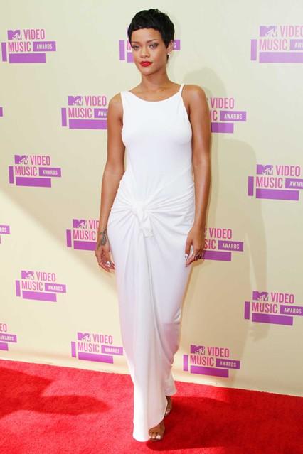 Rihanna wears a bespoke floor-length Adam Selman white dress, and Manolo Blahnik sandals to the MTV VMAs in September this year
