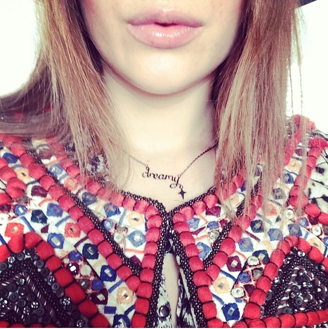 Rosie wears a Dreamy necklace from her collaboration with Laura Gravestock